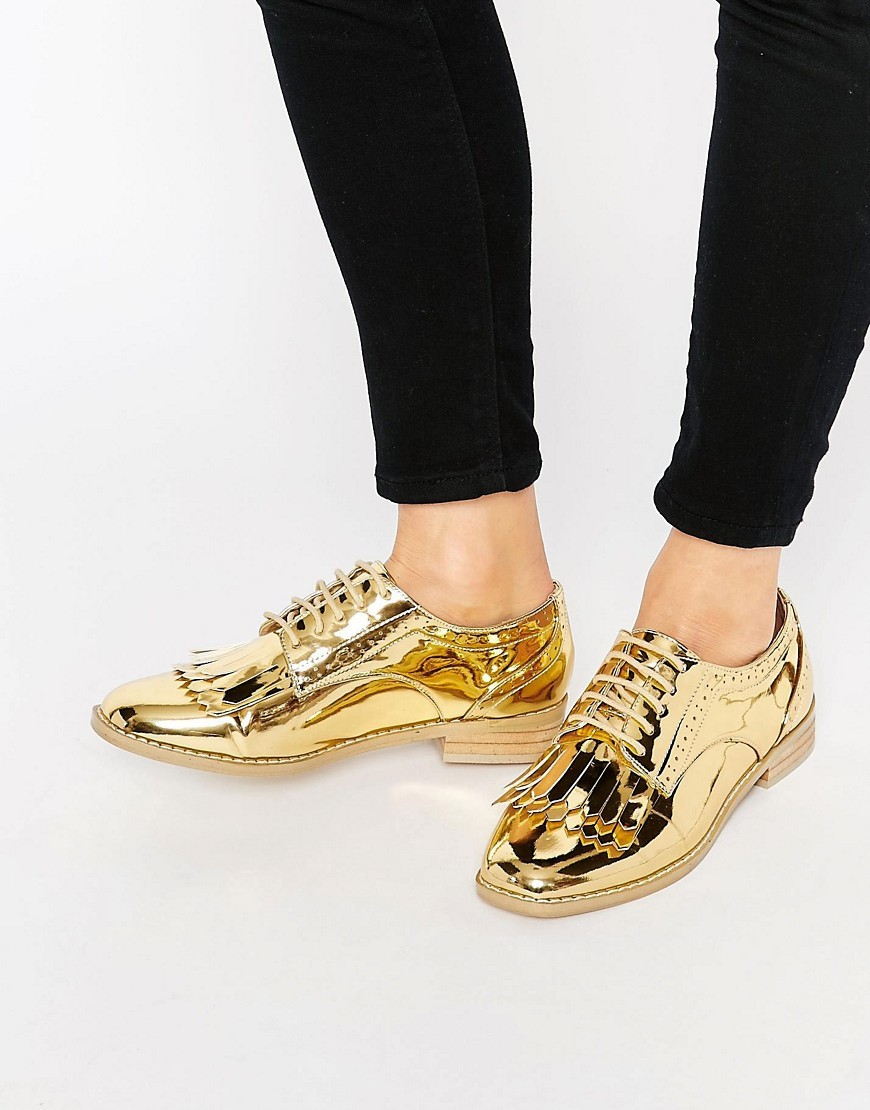 Missouri Fringed Brogues Gold - predominant colour: gold; occasions: evening; material: faux leather; heel height: flat; toe: pointed toe; style: brogues; finish: metallic; pattern: plain; embellishment: fringing; season: s/s 2016
