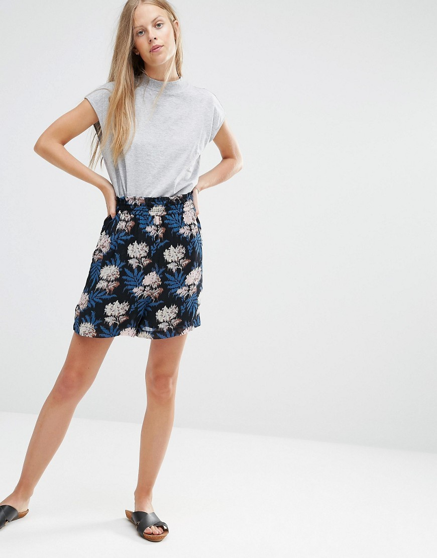 Park Row Georgette Floral Print Shorts Autumn Flower - waist: high rise; secondary colour: navy; predominant colour: black; occasions: casual, holiday; fibres: polyester/polyamide - 100%; pattern type: fabric; pattern: florals; texture group: woven light midweight; pattern size: big & busy (bottom); multicoloured: multicoloured; season: s/s 2016; style: culotte; length: mid thigh shorts; fit: baggy; wardrobe: holiday