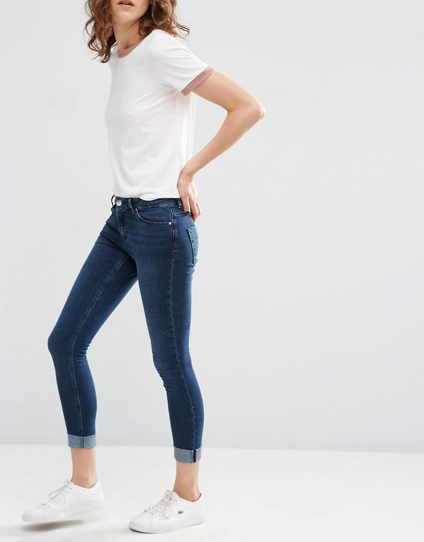 Lisbon Skinny Mid Rise Jeans In Dark Wash With Turn Up Dark Wash Blue - style: skinny leg; length: standard; pattern: plain; pocket detail: traditional 5 pocket; waist: mid/regular rise; predominant colour: navy; occasions: casual; fibres: cotton - stretch; texture group: denim; pattern type: fabric; season: s/s 2016; wardrobe: basic