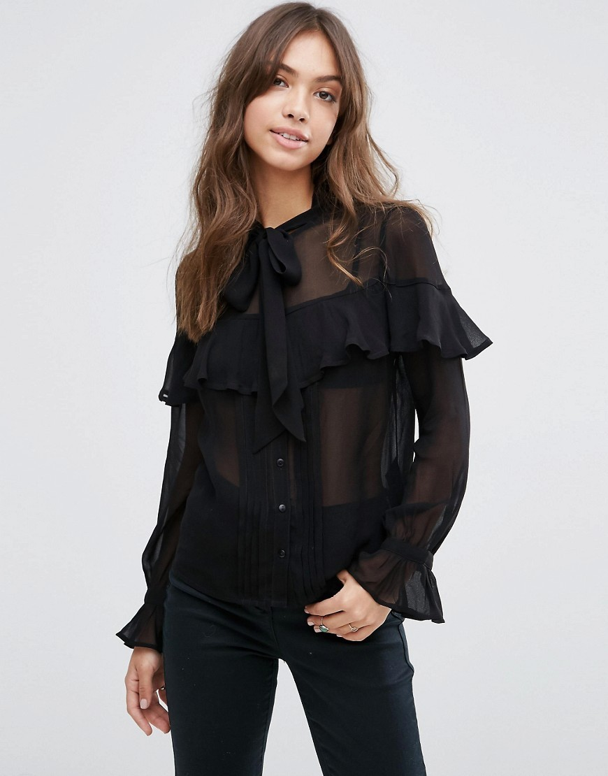 Ultimate Pussy Bow Ruffle Blouse Black - pattern: plain; neckline: pussy bow; style: blouse; predominant colour: black; occasions: evening; length: standard; fibres: viscose/rayon - 100%; fit: loose; sleeve length: long sleeve; sleeve style: standard; texture group: sheer fabrics/chiffon/organza etc.; bust detail: bulky details at bust; pattern type: fabric; season: s/s 2016; wardrobe: event