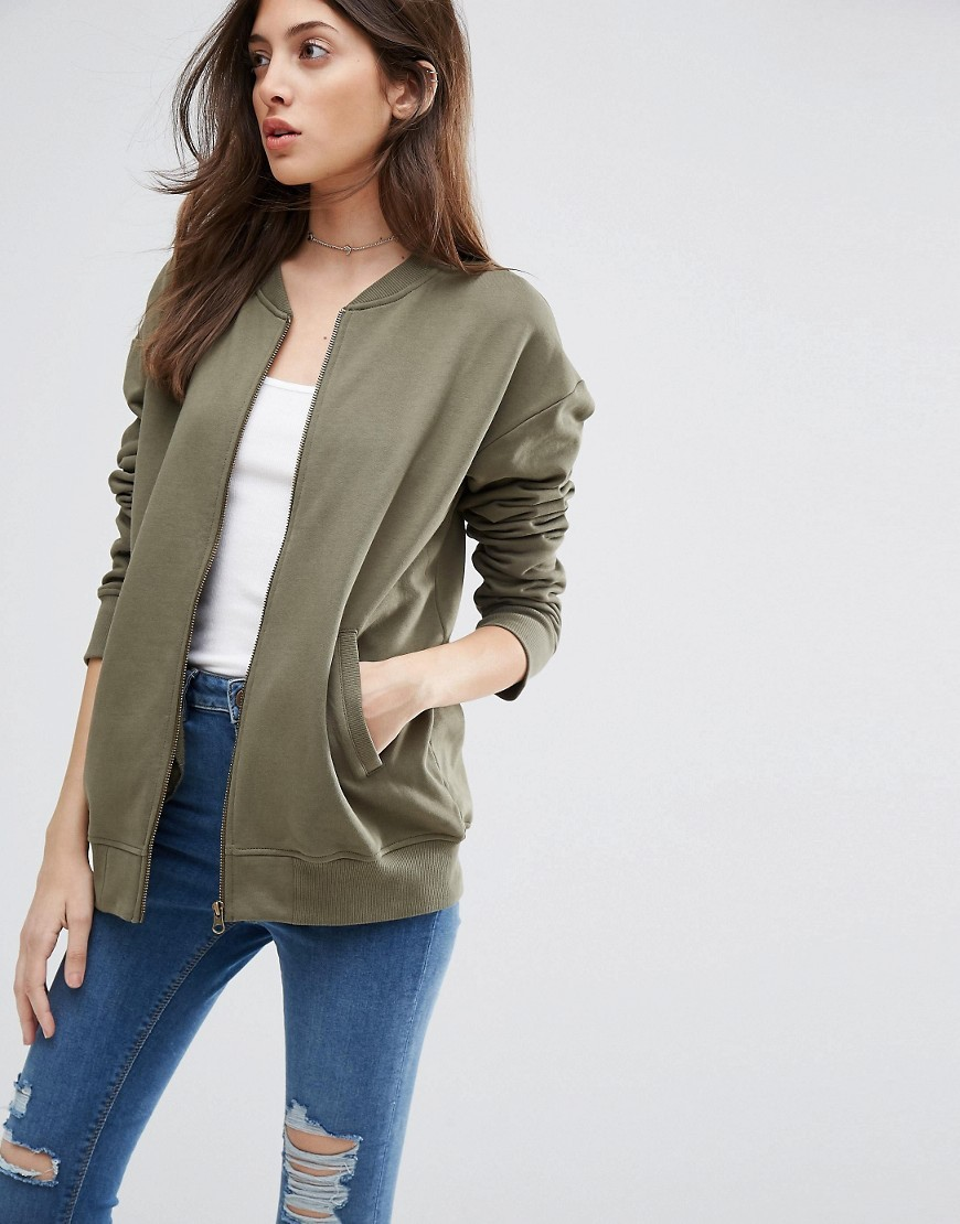 The Ultimate Bomber Jacket In Jersey Khaki - pattern: plain; collar: round collar/collarless; style: bomber; predominant colour: khaki; occasions: casual; length: standard; fit: straight cut (boxy); fibres: polyester/polyamide - 100%; sleeve length: long sleeve; sleeve style: standard; collar break: high; pattern type: fabric; texture group: jersey - stretchy/drapey; season: s/s 2016; wardrobe: basic