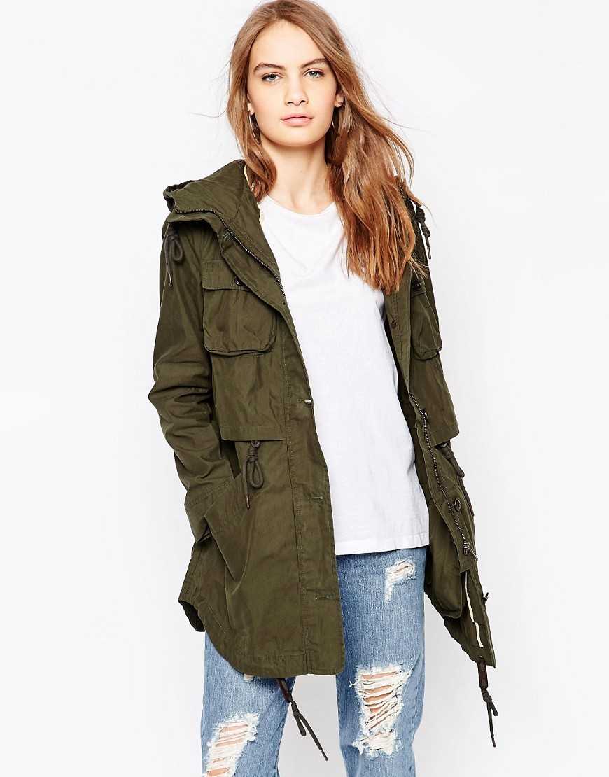 Longline Parka Khaki - pattern: plain; collar: funnel; fit: loose; style: parka; back detail: hood; length: mid thigh; predominant colour: khaki; occasions: casual; fibres: cotton - 100%; sleeve length: long sleeve; sleeve style: standard; texture group: cotton feel fabrics; collar break: high; pattern type: fabric; season: s/s 2016
