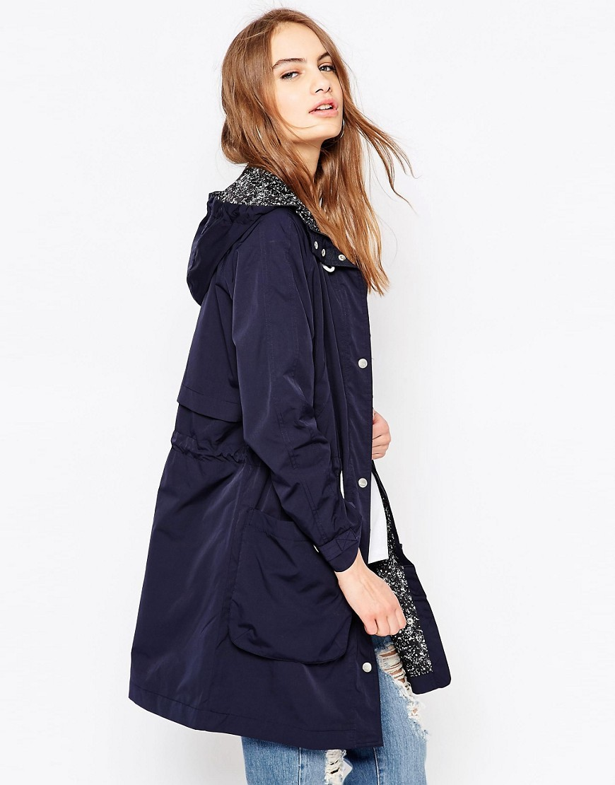 Dana Lightweight Parka Indigo - pattern: plain; collar: funnel; fit: loose; style: parka; back detail: hood; length: mid thigh; predominant colour: navy; occasions: casual, creative work; fibres: polyester/polyamide - mix; waist detail: belted waist/tie at waist/drawstring; sleeve length: long sleeve; sleeve style: standard; texture group: technical outdoor fabrics; collar break: high; pattern type: fabric; season: s/s 2016; wardrobe: basic