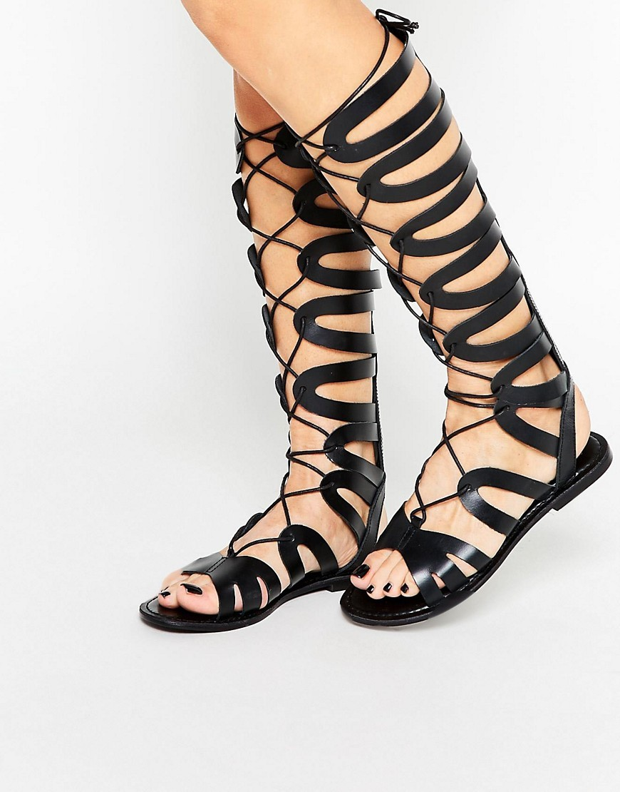 Flyway Leather Knee High Gladiator Sandals Black - predominant colour: black; occasions: casual, holiday; material: leather; heel height: flat; ankle detail: ankle tie; heel: block; toe: open toe/peeptoe; style: gladiators; finish: plain; pattern: plain; season: s/s 2016; wardrobe: basic