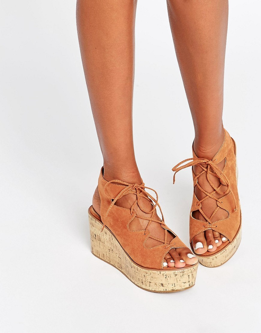 Torch Lace Up Wedges Chestnut - predominant colour: tan; occasions: casual, holiday; material: suede; heel height: high; ankle detail: ankle tie; heel: wedge; toe: open toe/peeptoe; style: strappy; finish: plain; pattern: plain; shoe detail: platform; season: s/s 2016; wardrobe: highlight