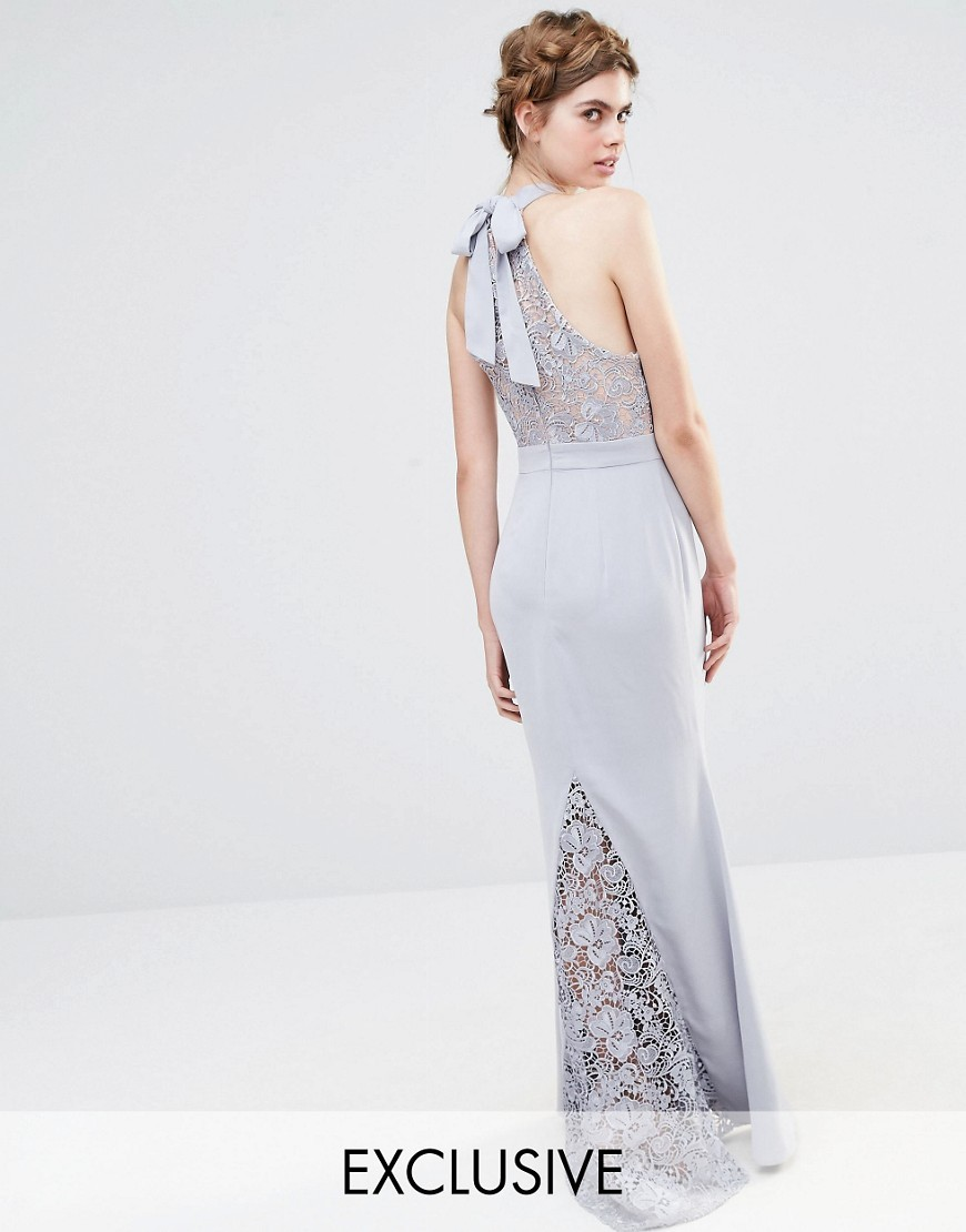Wedding High Neck Lace Maxi Dress With Bow Back Silver Grey - pattern: plain; sleeve style: sleeveless; style: maxi dress; bust detail: sheer at bust; predominant colour: lilac; occasions: evening; length: floor length; fit: body skimming; fibres: polyester/polyamide - 100%; sleeve length: sleeveless; pattern type: fabric; texture group: jersey - stretchy/drapey; embellishment: lace; season: s/s 2016; neckline: high halter neck; wardrobe: event; embellishment location: back, skirt