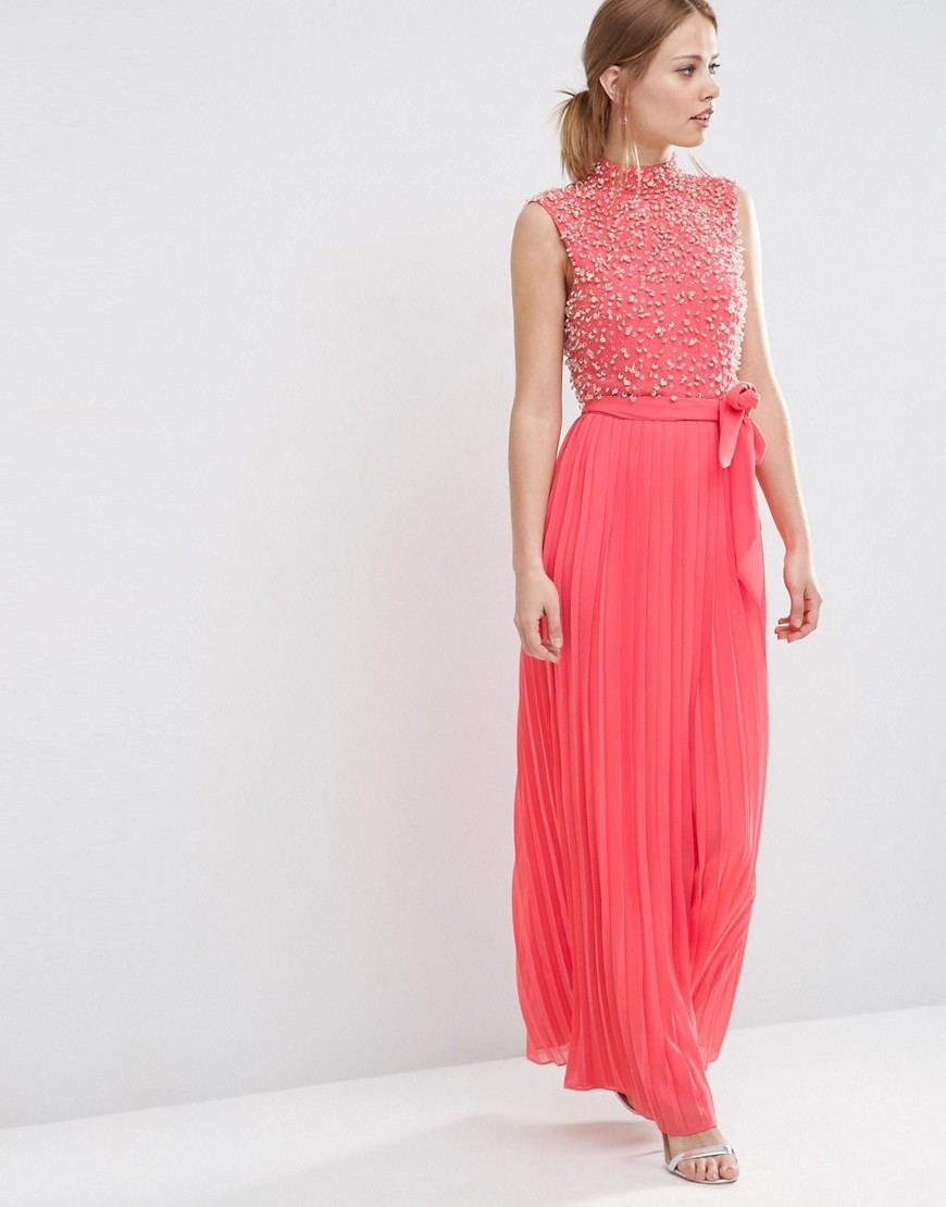 Pearl Bodice Maxi Dress Coral - pattern: plain; sleeve style: sleeveless; style: maxi dress; neckline: high neck; length: ankle length; waist detail: belted waist/tie at waist/drawstring; secondary colour: ivory/cream; predominant colour: pink; fit: body skimming; fibres: polyester/polyamide - 100%; occasions: occasion; sleeve length: sleeveless; texture group: sheer fabrics/chiffon/organza etc.; pattern type: fabric; embellishment: pearls; season: s/s 2016; wardrobe: event; embellishment location: top