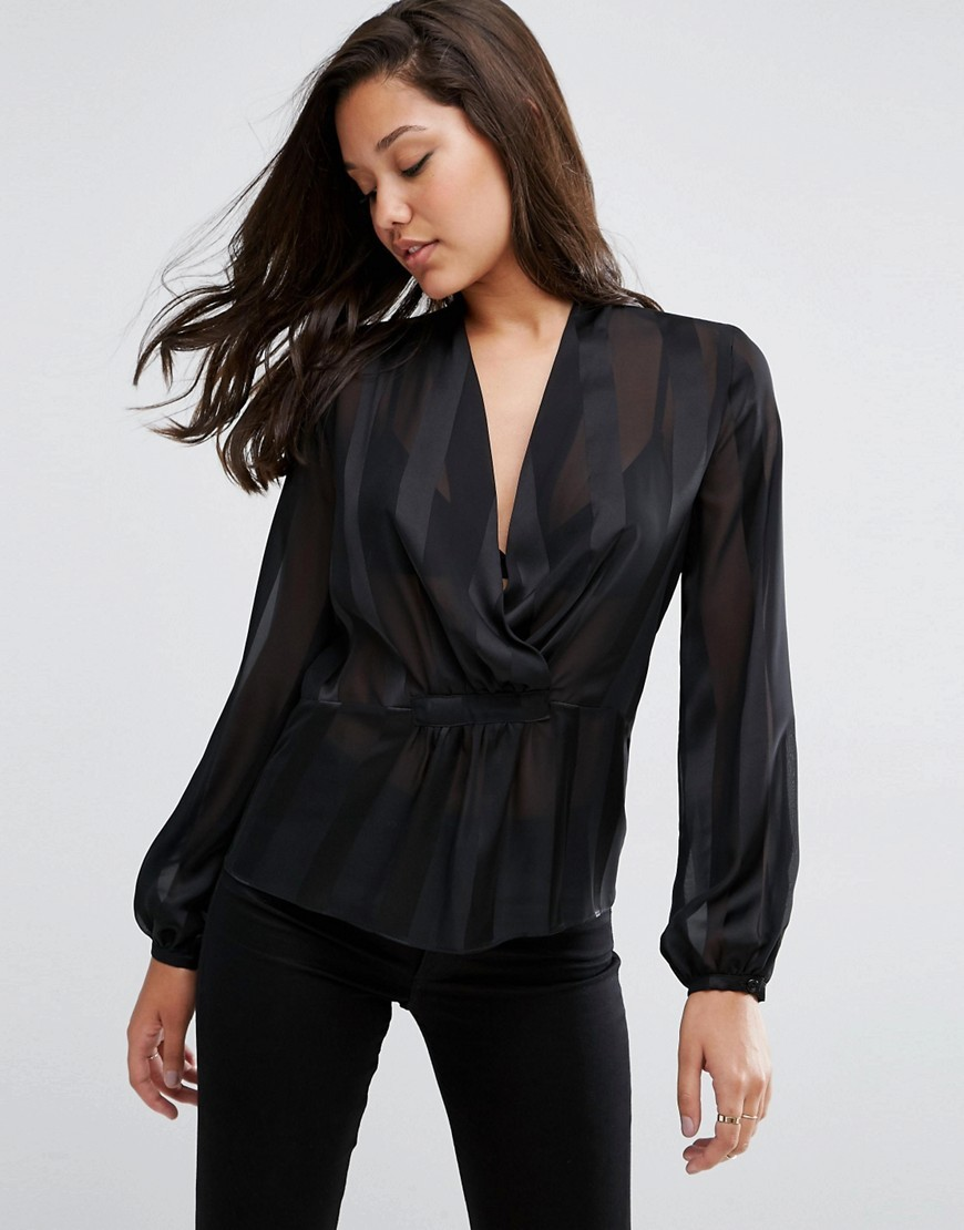 Wrap Front Blouse In Sheer & Solid Stripe Black - neckline: v-neck; pattern: plain; style: wrap/faux wrap; sleeve style: balloon; predominant colour: black; occasions: work; length: standard; fibres: polyester/polyamide - 100%; fit: tailored/fitted; sleeve length: long sleeve; texture group: sheer fabrics/chiffon/organza etc.; pattern type: fabric; season: s/s 2016; wardrobe: basic