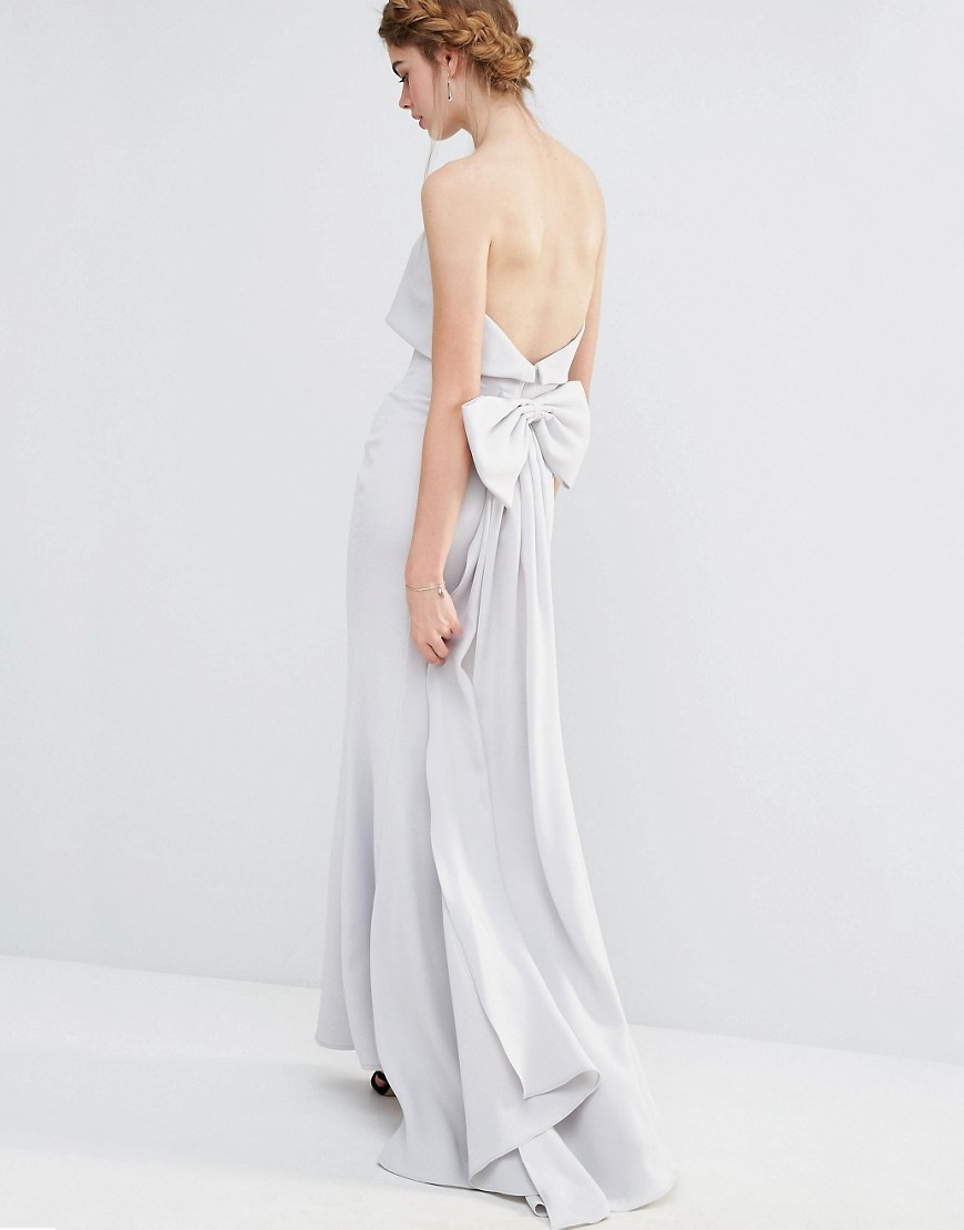 Wedding Overlay Maxi Dress With Fishtail And Oversized Bow Back Silver Grey - neckline: strapless (straight/sweetheart); pattern: plain; style: maxi dress; sleeve style: strapless; length: ankle length; predominant colour: light grey; occasions: evening, occasion; fit: body skimming; fibres: polyester/polyamide - 100%; back detail: longer hem at back than at front; sleeve length: sleeveless; texture group: crepes; pattern type: fabric; embellishment: bow; season: s/s 2016; wardrobe: event; embellishment location: back