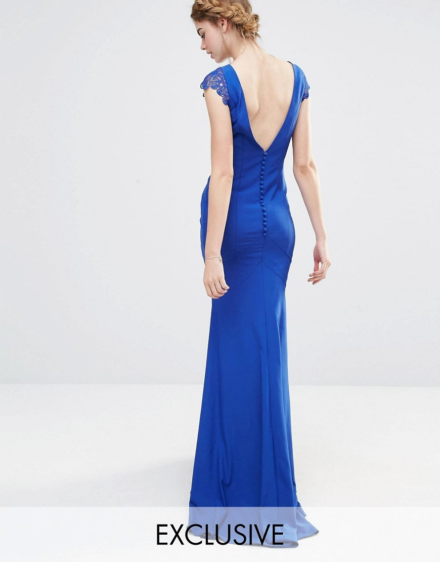 Wedding Fishtail Maxi Dress With Lace Cap Sleeve And Button Back Navy - sleeve style: capped; fit: tailored/fitted; pattern: plain; back detail: low cut/open back; predominant colour: royal blue; occasions: evening; length: floor length; fibres: polyester/polyamide - 100%; style: fishtail; neckline: crew; sleeve length: short sleeve; texture group: crepes; pattern type: fabric; embellishment: lace; season: s/s 2016; wardrobe: event