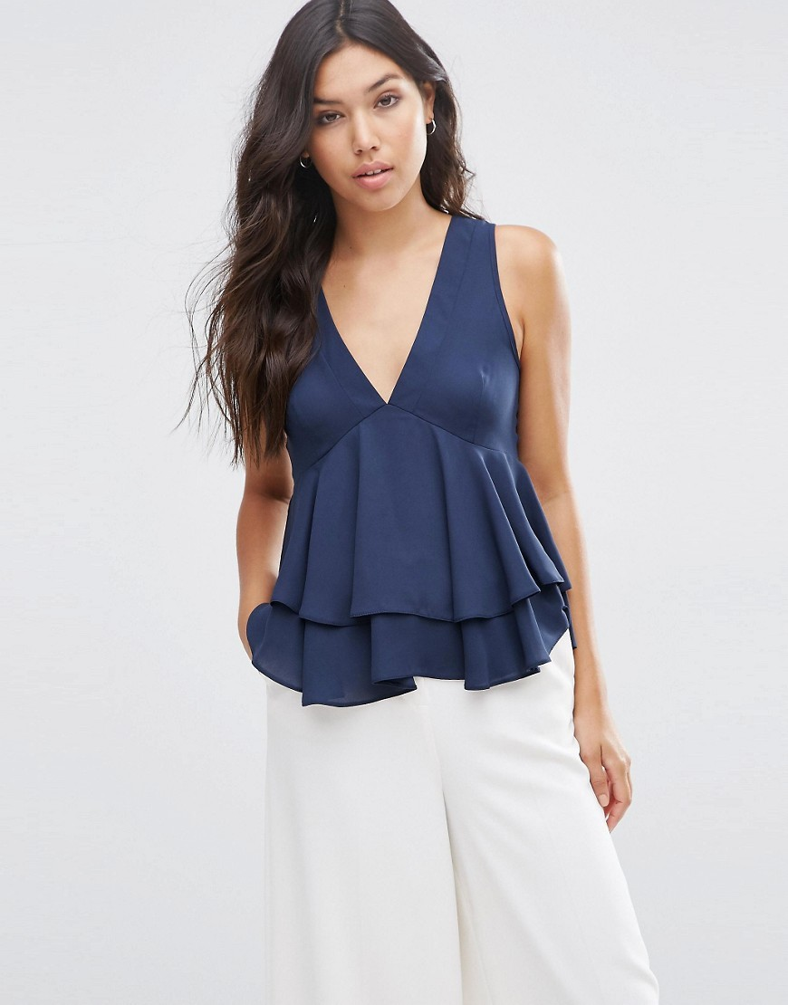Tiered Ruffle Vest Navy - neckline: low v-neck; pattern: plain; sleeve style: sleeveless; style: vest top; predominant colour: navy; occasions: casual; length: standard; fibres: polyester/polyamide - 100%; fit: body skimming; hip detail: adds bulk at the hips; sleeve length: sleeveless; pattern type: fabric; texture group: jersey - stretchy/drapey; season: s/s 2016; wardrobe: highlight