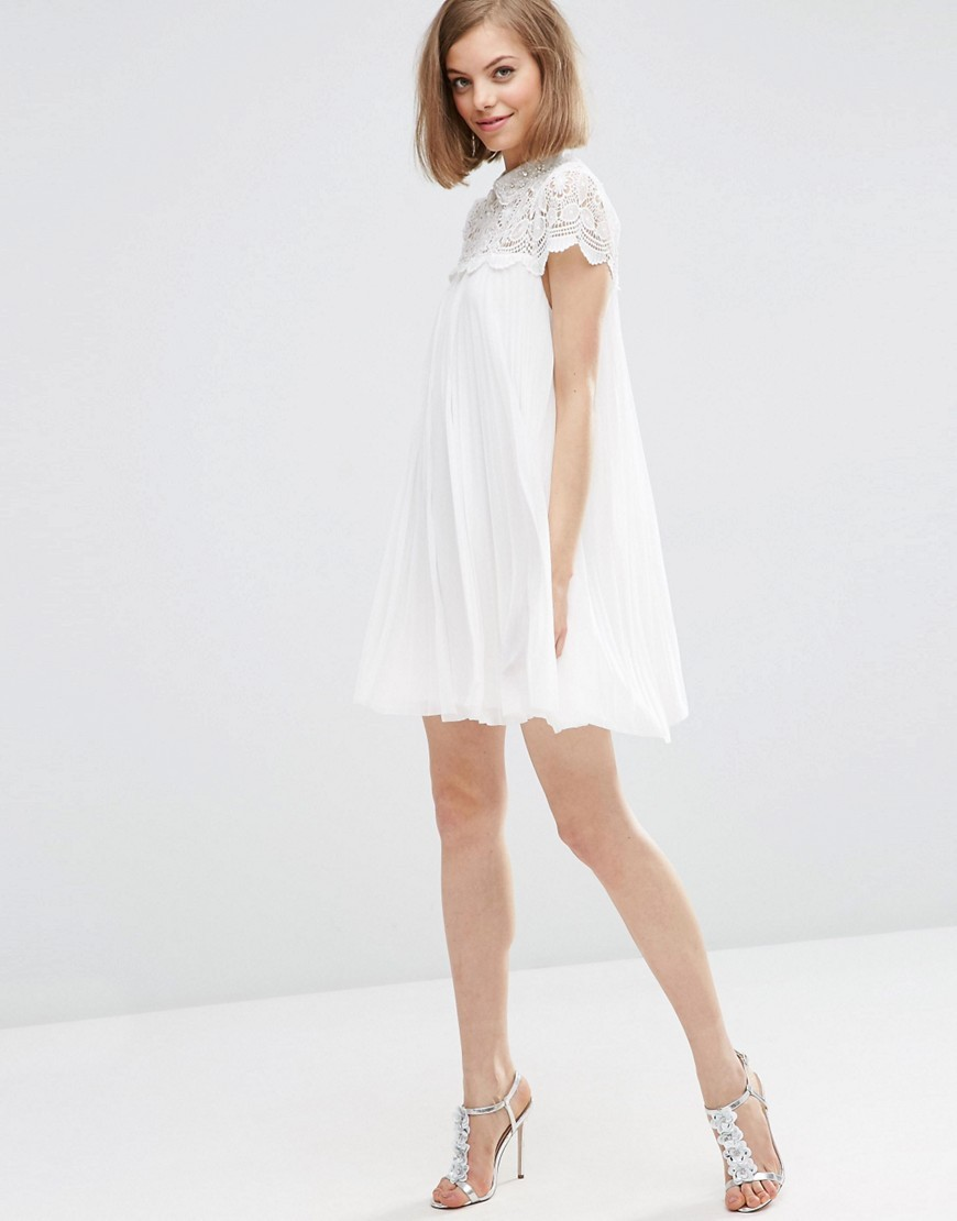 Lace Top Pleated Mini Swing Dress White - style: smock; length: mid thigh; fit: loose; pattern: plain; bust detail: sheer at bust; predominant colour: white; occasions: evening; fibres: polyester/polyamide - 100%; neckline: crew; sleeve length: short sleeve; sleeve style: standard; texture group: sheer fabrics/chiffon/organza etc.; pattern type: fabric; embellishment: lace; season: s/s 2016; wardrobe: event