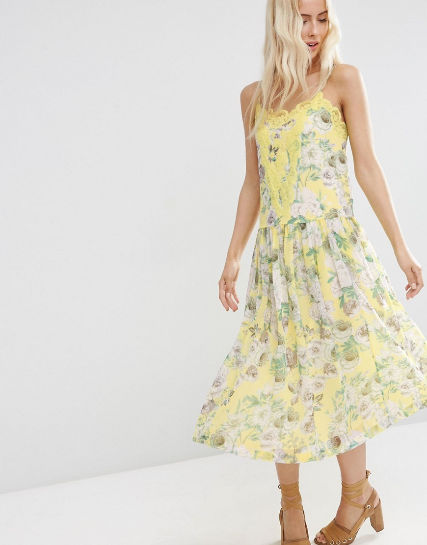Premium Pretty Floral Midi Cami Dress With Lace Insert Yellow Print - length: calf length; neckline: low v-neck; sleeve style: spaghetti straps; secondary colour: white; predominant colour: primrose yellow; occasions: casual, holiday; fit: soft a-line; style: slip dress; fibres: polyester/polyamide - 100%; hip detail: subtle/flattering hip detail; sleeve length: sleeveless; texture group: sheer fabrics/chiffon/organza etc.; pattern type: fabric; pattern: patterned/print; embellishment: lace; season: s/s 2016; wardrobe: highlight; embellishment location: bust