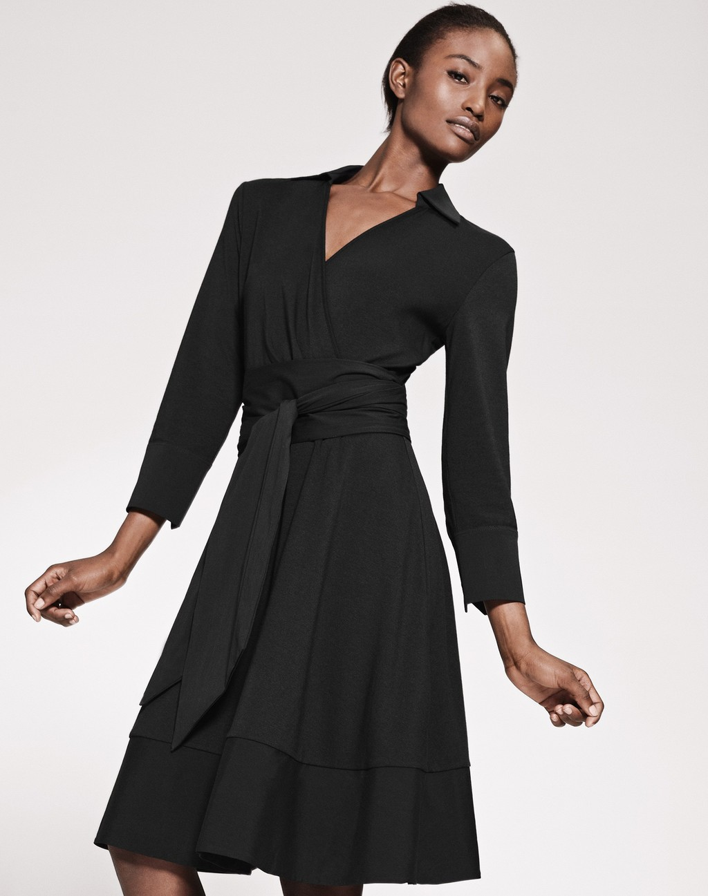 All Day Dress Black - style: faux wrap/wrap; neckline: v-neck; fit: tailored/fitted; pattern: plain; waist detail: belted waist/tie at waist/drawstring; predominant colour: black; occasions: work, occasion; length: on the knee; fibres: cotton - stretch; hip detail: soft pleats at hip/draping at hip/flared at hip; sleeve length: 3/4 length; sleeve style: standard; pattern type: fabric; texture group: jersey - stretchy/drapey; season: s/s 2016