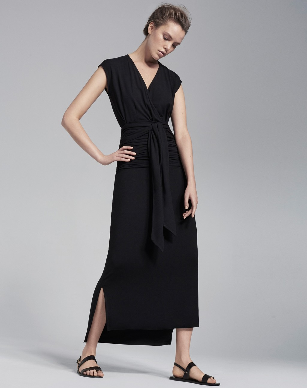 Ruched Wrap Maxi Dress Black - style: faux wrap/wrap; neckline: v-neck; pattern: plain; sleeve style: sleeveless; length: ankle length; waist detail: twist front waist detail/nipped in at waist on one side/soft pleats/draping/ruching/gathering waist detail; predominant colour: black; occasions: casual, evening, creative work; fit: body skimming; fibres: polyester/polyamide - stretch; sleeve length: sleeveless; pattern type: fabric; texture group: jersey - stretchy/drapey; season: s/s 2016