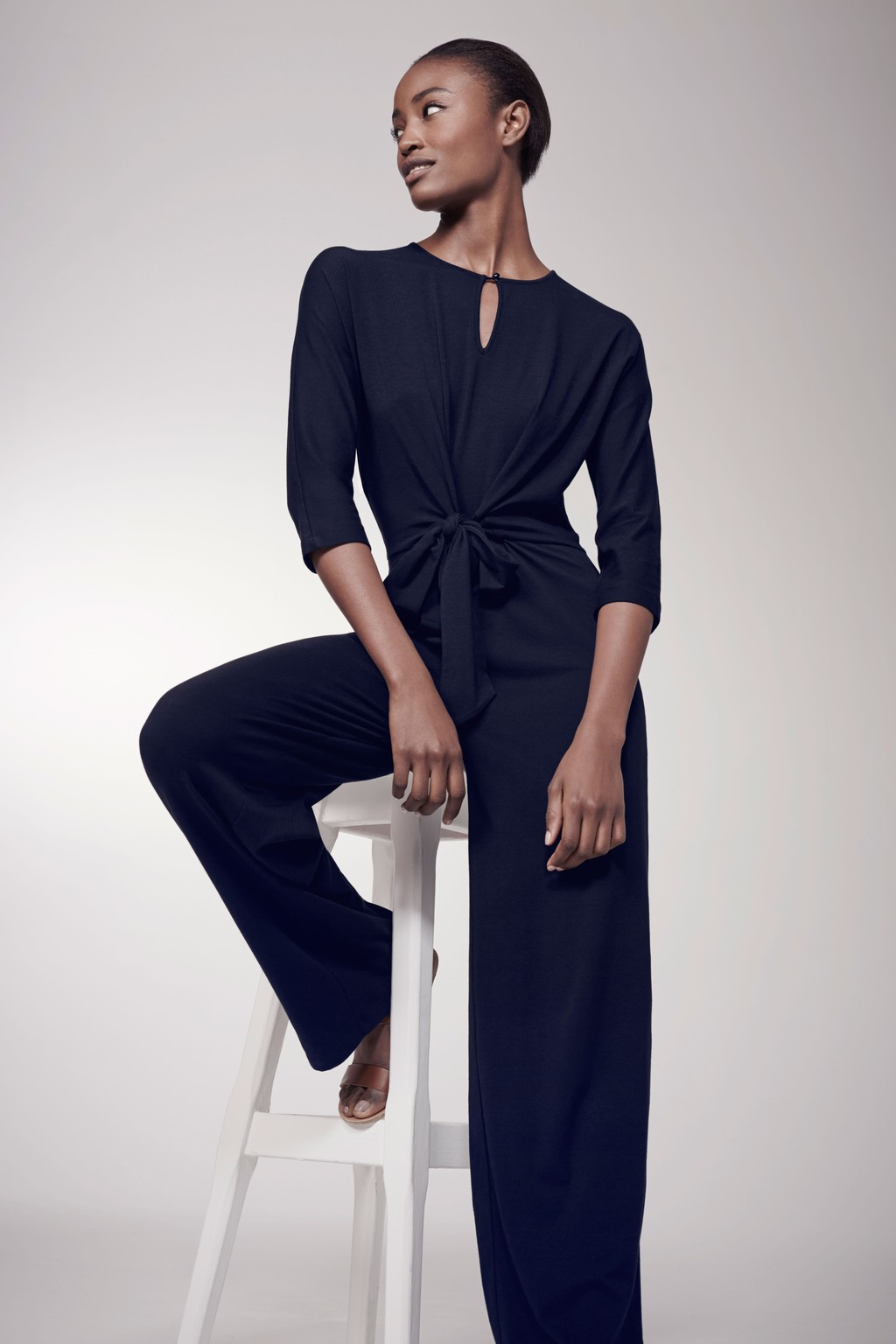 Tie Front Jumpsuit Navy - length: standard; fit: tailored/fitted; pattern: plain; waist detail: flattering waist detail; predominant colour: navy; occasions: evening, occasion; neckline: peep hole neckline; fibres: polyester/polyamide - 100%; sleeve length: 3/4 length; sleeve style: standard; style: jumpsuit; pattern type: fabric; texture group: jersey - stretchy/drapey; season: s/s 2016; wardrobe: event