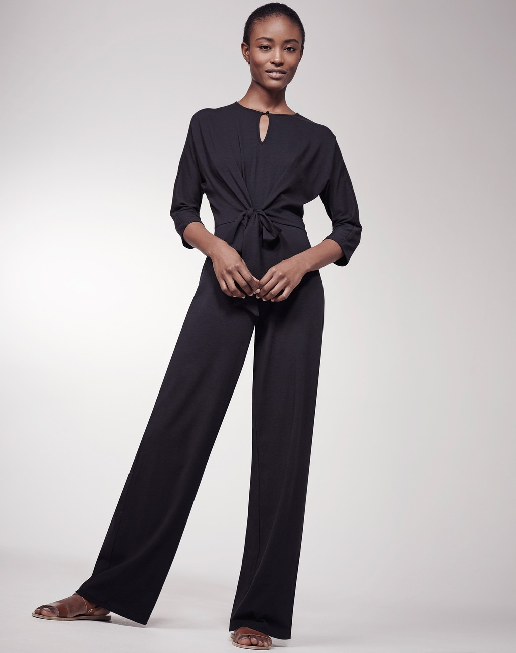 Tie Front Jumpsuit Black - length: standard; fit: tailored/fitted; pattern: plain; waist detail: twist front waist detail/nipped in at waist on one side/soft pleats/draping/ruching/gathering waist detail; predominant colour: black; occasions: evening, occasion; neckline: peep hole neckline; fibres: polyester/polyamide - stretch; sleeve length: 3/4 length; sleeve style: standard; style: jumpsuit; pattern type: fabric; texture group: other - light to midweight; season: s/s 2016; wardrobe: event