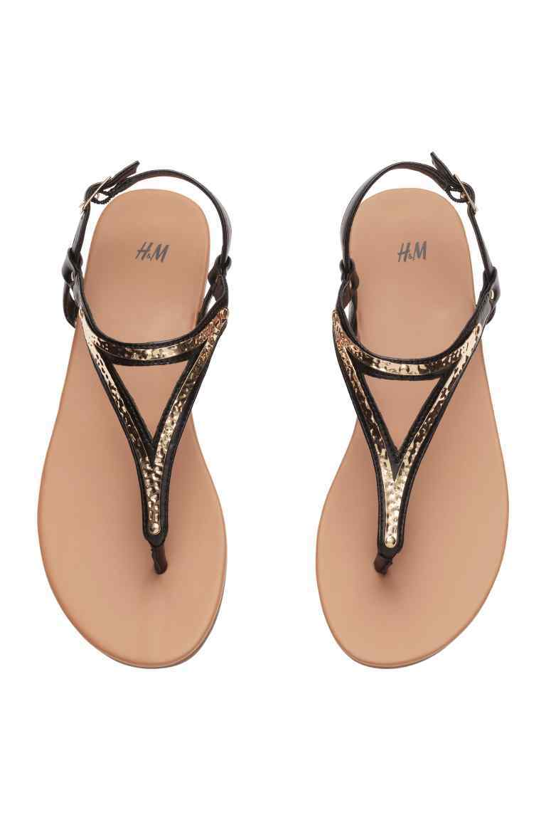 Sandals - secondary colour: gold; predominant colour: black; occasions: casual, holiday; material: leather; heel height: flat; ankle detail: ankle strap; heel: block; toe: toe thongs; style: standard; finish: metallic; pattern: plain; season: s/s 2016; wardrobe: basic