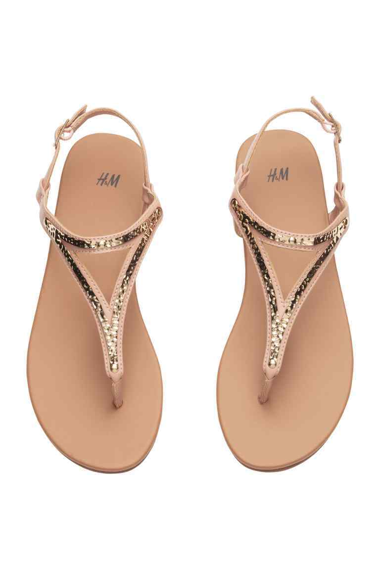 Sandals - secondary colour: camel; predominant colour: gold; occasions: casual, holiday; material: faux leather; heel height: flat; ankle detail: ankle strap; heel: block; toe: toe thongs; style: strappy; finish: metallic; pattern: plain; season: s/s 2016; wardrobe: basic