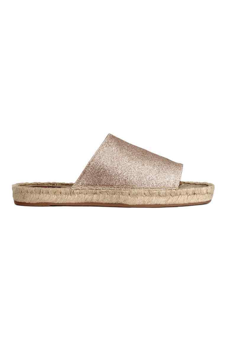 Mules - predominant colour: gold; occasions: casual; material: faux leather; heel height: flat; heel: standard; toe: open toe/peeptoe; style: slides; finish: metallic; pattern: plain; season: s/s 2016