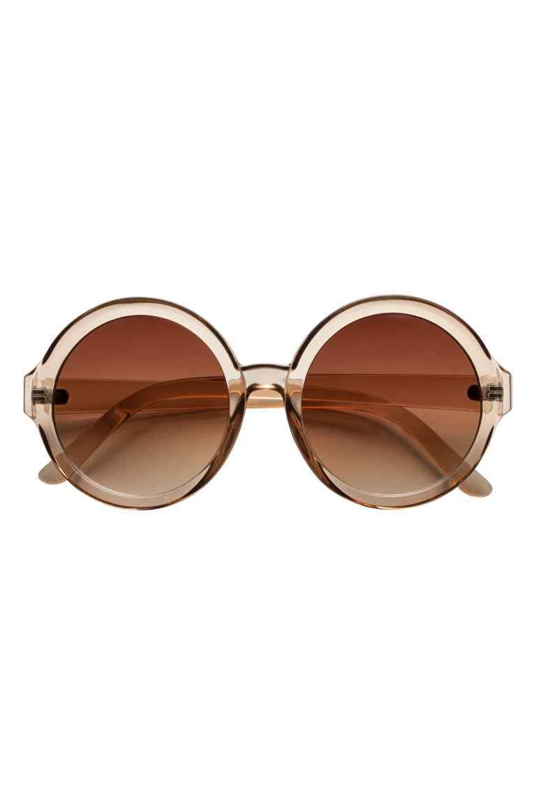 Round Sunglasses - predominant colour: nude; occasions: casual, holiday; style: round; size: large; material: plastic/rubber; pattern: plain; finish: plain; season: s/s 2016; wardrobe: basic