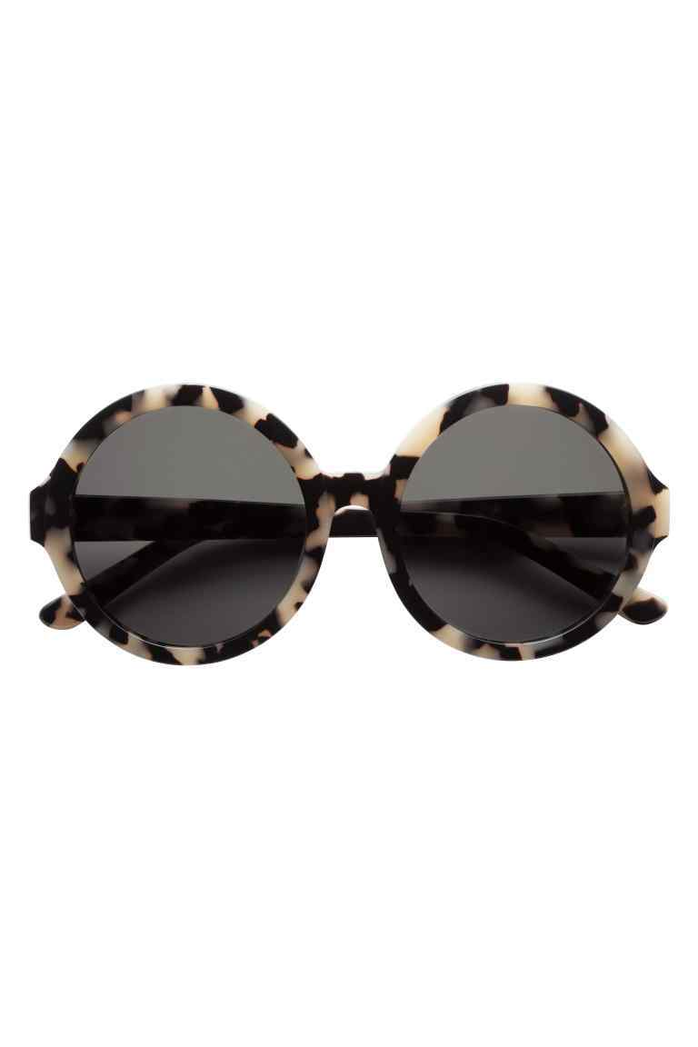 Polarised Sunglasses - predominant colour: black; occasions: casual, holiday; style: round; size: standard; material: plastic/rubber; pattern: animal print; finish: plain; season: s/s 2016; wardrobe: highlight