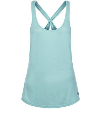 Mint Green Knot Back Sports Vest - pattern: plain; sleeve style: sleeveless; style: vest top; predominant colour: turquoise; occasions: casual; length: standard; neckline: scoop; fibres: cotton - mix; fit: body skimming; back detail: crossover; sleeve length: sleeveless; pattern type: fabric; texture group: jersey - stretchy/drapey; season: s/s 2016; wardrobe: highlight