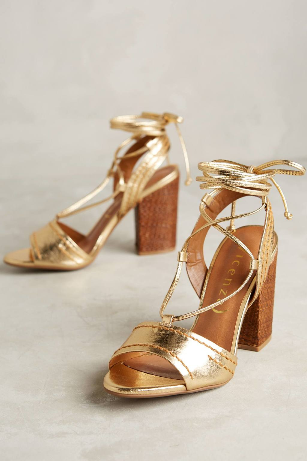 Beatriz Gold Lace Up Heels - predominant colour: gold; occasions: evening, occasion; material: leather; heel height: high; ankle detail: ankle tie; heel: block; toe: open toe/peeptoe; style: strappy; finish: metallic; pattern: plain; season: s/s 2016; wardrobe: event