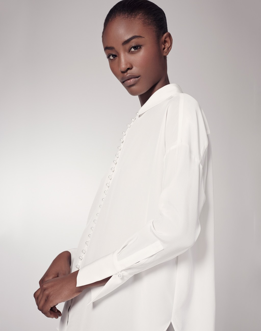 Oversized Silk Blouse - neckline: shirt collar/peter pan/zip with opening; pattern: plain; length: below the bottom; style: shirt; predominant colour: white; occasions: casual; fibres: silk - 100%; fit: loose; sleeve length: long sleeve; sleeve style: standard; texture group: silky - light; pattern type: fabric; season: s/s 2016; wardrobe: basic
