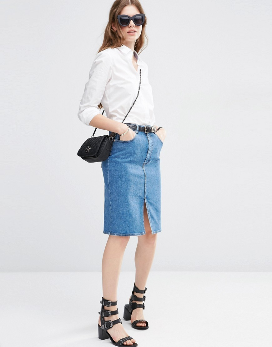 Denim Pencil Skirt In Mid Wash Blue Blue - pattern: plain; style: pencil; fit: body skimming; waist: mid/regular rise; predominant colour: denim; occasions: casual; length: on the knee; fibres: cotton - stretch; texture group: denim; pattern type: fabric; season: s/s 2016; wardrobe: basic