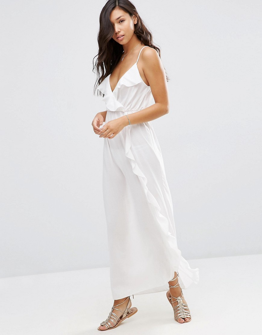 Wrap Front Frill Maxi Beach Dress Cream - neckline: low v-neck; sleeve style: spaghetti straps; pattern: plain; style: maxi dress; length: ankle length; predominant colour: white; occasions: casual; fit: body skimming; fibres: viscose/rayon - 100%; sleeve length: sleeveless; bust detail: bulky details at bust; pattern type: fabric; texture group: jersey - stretchy/drapey; season: s/s 2016; wardrobe: highlight