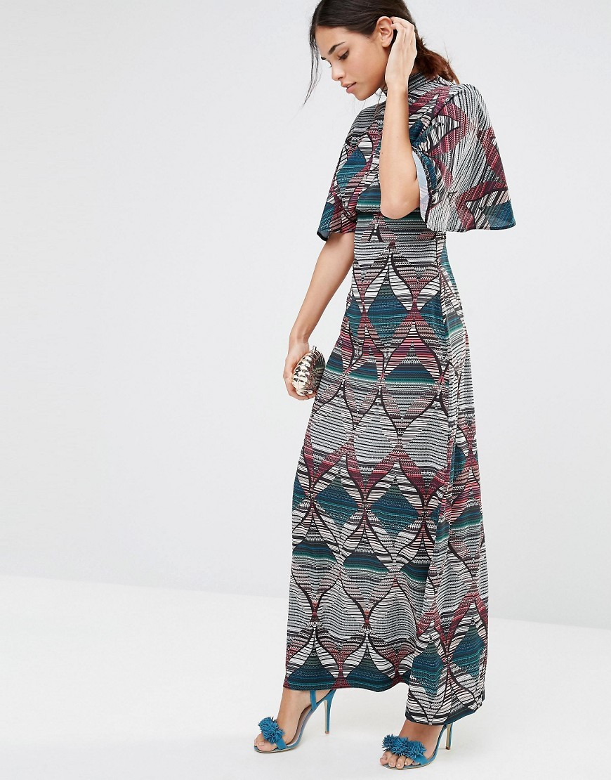 Geometric Print Maxi Dress With Slit Front And Frill Sleeves Multi - style: maxi dress; length: ankle length; secondary colour: turquoise; predominant colour: mid grey; fit: body skimming; fibres: polyester/polyamide - 100%; occasions: occasion; neckline: crew; sleeve length: half sleeve; sleeve style: standard; pattern type: fabric; pattern size: standard; pattern: patterned/print; texture group: other - light to midweight; multicoloured: multicoloured; season: s/s 2016; wardrobe: event