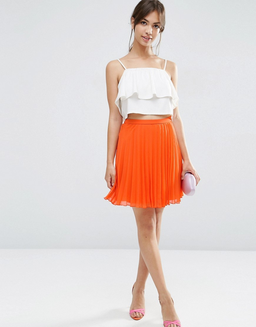 Pleated Mini Skirt Orange - length: mid thigh; pattern: plain; fit: loose/voluminous; style: pleated; waist: high rise; predominant colour: bright orange; fibres: polyester/polyamide - 100%; occasions: occasion, creative work; hip detail: adds bulk at the hips; waist detail: feature waist detail; texture group: sheer fabrics/chiffon/organza etc.; pattern type: fabric; season: s/s 2016; wardrobe: highlight