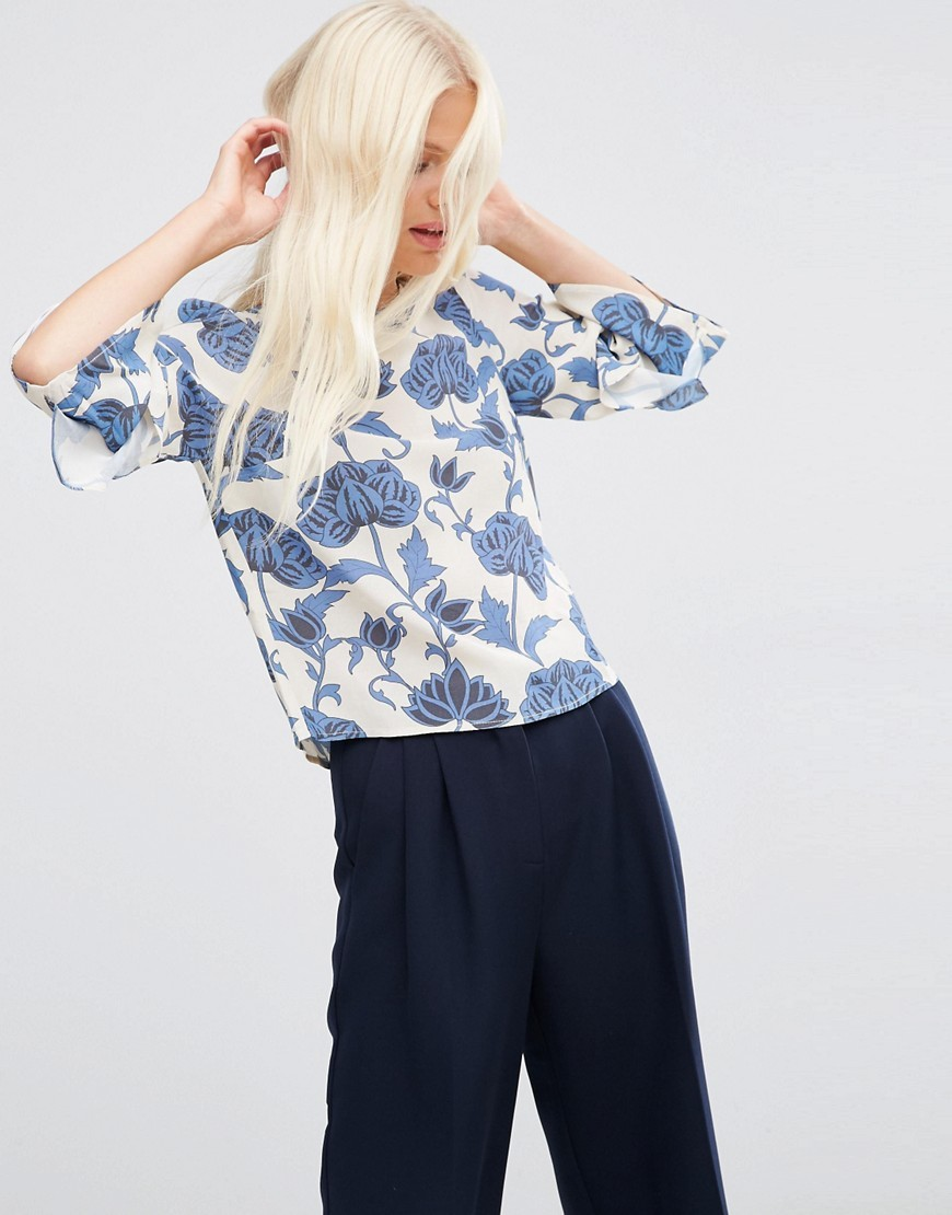 Ruffle Sleeve Tee In Blue Floral Multi - predominant colour: white; secondary colour: denim; occasions: casual; length: standard; style: top; fibres: viscose/rayon - 100%; fit: body skimming; neckline: crew; sleeve length: 3/4 length; sleeve style: standard; pattern type: fabric; pattern: florals; texture group: jersey - stretchy/drapey; pattern size: big & busy (top); multicoloured: multicoloured; season: s/s 2016