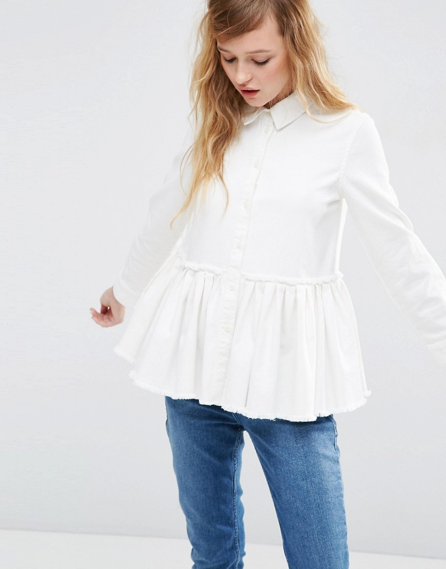 Denim Drop Waist Pleated Shirt In White With Raw Hem White - neckline: shirt collar/peter pan/zip with opening; pattern: plain; length: below the bottom; style: shirt; waist detail: peplum waist detail; predominant colour: white; occasions: casual, creative work; fibres: cotton - 100%; fit: loose; sleeve length: long sleeve; sleeve style: standard; texture group: cotton feel fabrics; pattern type: fabric; season: s/s 2016; wardrobe: basic