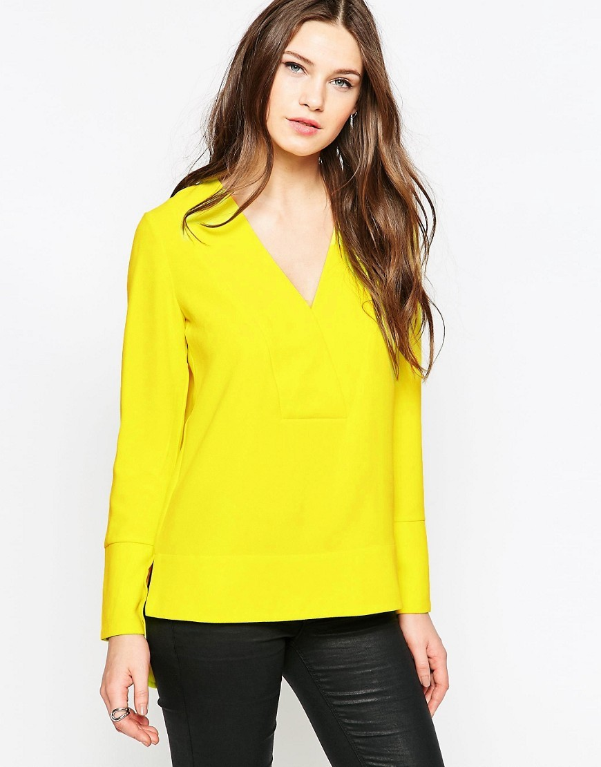 Arrow Crepe V Neck Tunic Acid Blonde - neckline: low v-neck; pattern: plain; length: below the bottom; predominant colour: yellow; style: top; fibres: polyester/polyamide - 100%; fit: body skimming; sleeve length: long sleeve; sleeve style: standard; pattern type: fabric; texture group: other - light to midweight; occasions: creative work; season: s/s 2016; wardrobe: highlight