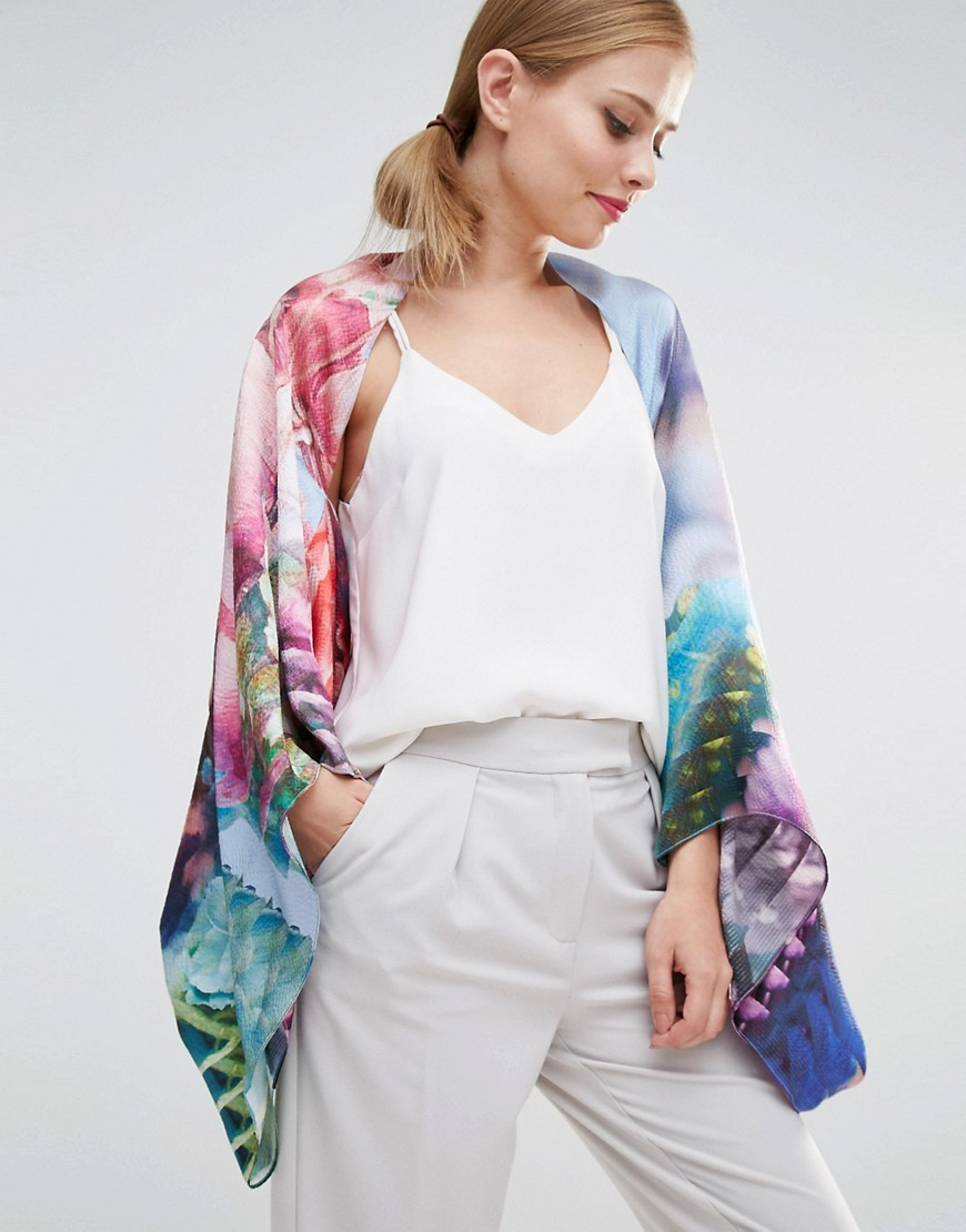 Hira Floral Cape Pale Blue - sleeve style: dolman/batwing; length: below the bottom; neckline: collarless open; style: open front; secondary colour: pink; predominant colour: pale blue; occasions: evening; fibres: silk - mix; fit: loose; sleeve length: 3/4 length; texture group: silky - light; pattern type: fabric; pattern: florals; pattern size: big & busy (top); multicoloured: multicoloured; season: s/s 2016; wardrobe: event