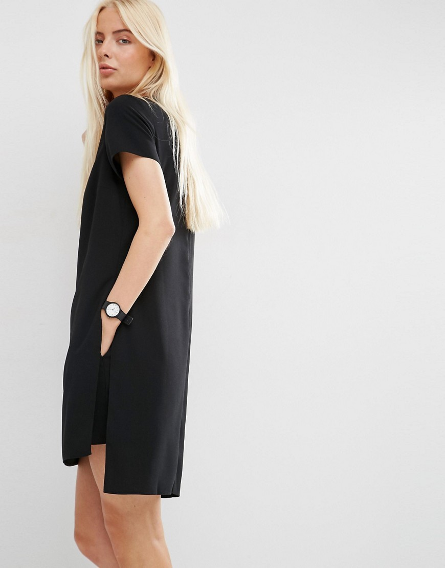Minimal Playsuit With Short Sleeve Black - neckline: v-neck; fit: loose; pattern: plain; length: mid thigh shorts; predominant colour: black; occasions: evening; fibres: polyester/polyamide - 100%; sleeve length: short sleeve; sleeve style: standard; texture group: crepes; style: playsuit; pattern type: fabric; season: s/s 2016; wardrobe: event