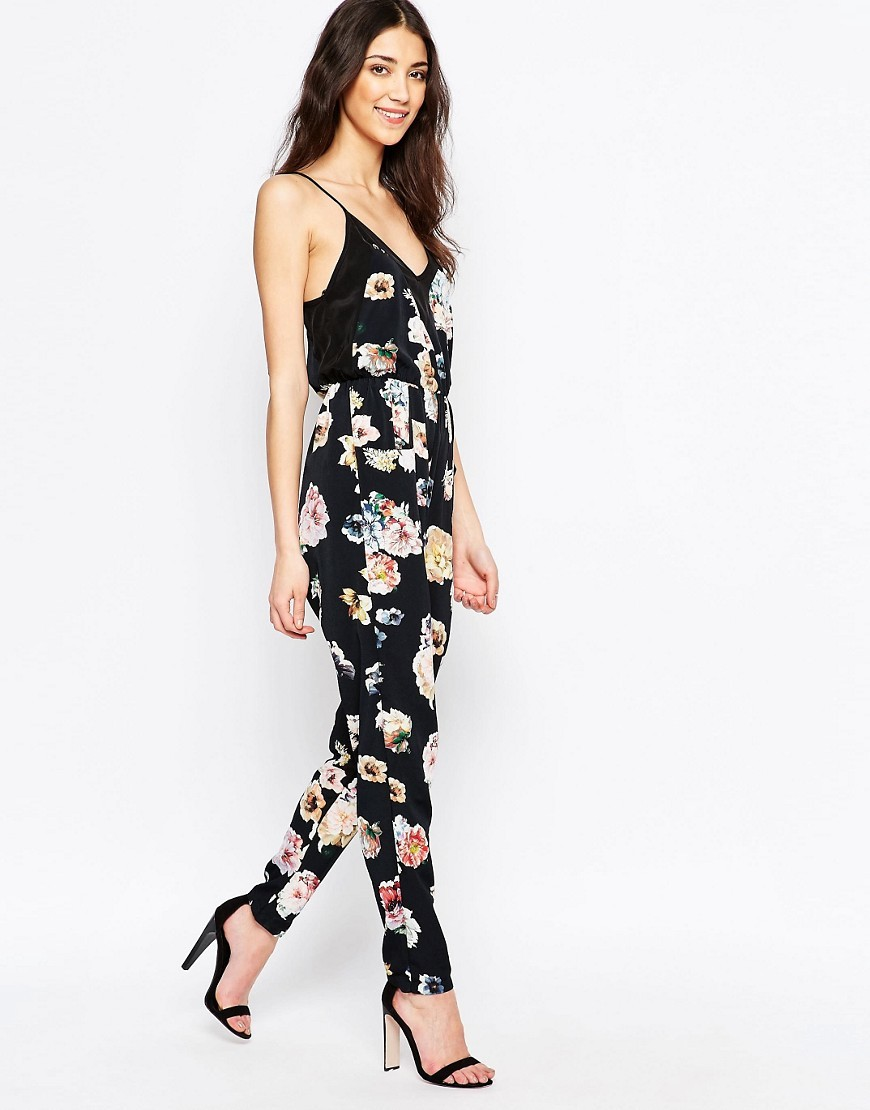 Floral Jumpsuit Midnight Blossom - length: standard; neckline: low v-neck; sleeve style: spaghetti straps; predominant colour: black; occasions: casual, holiday; fit: body skimming; fibres: polyester/polyamide - 100%; sleeve length: sleeveless; style: jumpsuit; pattern type: fabric; pattern size: big & busy; pattern: florals; texture group: other - light to midweight; multicoloured: multicoloured; season: s/s 2016; wardrobe: holiday