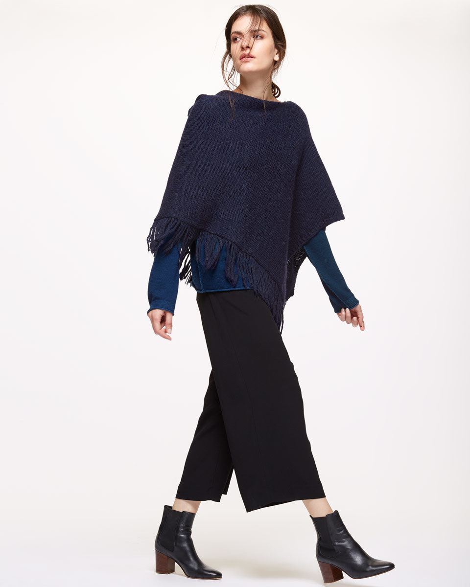 Fringed Poncho - neckline: slash/boat neckline; pattern: plain; hip detail: front pockets at hip; style: poncho; predominant colour: navy; occasions: casual; length: standard; fibres: wool - mix; fit: loose; sleeve length: 3/4 length; texture group: knits/crochet; pattern type: knitted - other; embellishment: fringing; sleeve style: cape/poncho sleeve; season: s/s 2016; wardrobe: highlight