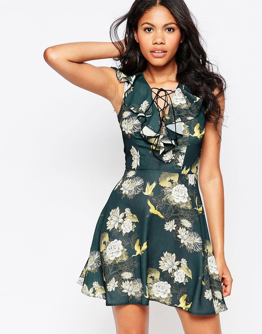 Printed Skater Dress Multi - length: mini; neckline: v-neck; sleeve style: sleeveless; waist detail: fitted waist; secondary colour: ivory/cream; predominant colour: dark green; occasions: evening; fit: fitted at waist & bust; style: fit & flare; fibres: polyester/polyamide - stretch; hip detail: soft pleats at hip/draping at hip/flared at hip; sleeve length: sleeveless; bust detail: tiers/frills/bulky drapes/pleats; pattern type: fabric; pattern size: standard; pattern: florals; texture group: jersey - stretchy/drapey; multicoloured: multicoloured; season: s/s 2016; wardrobe: event