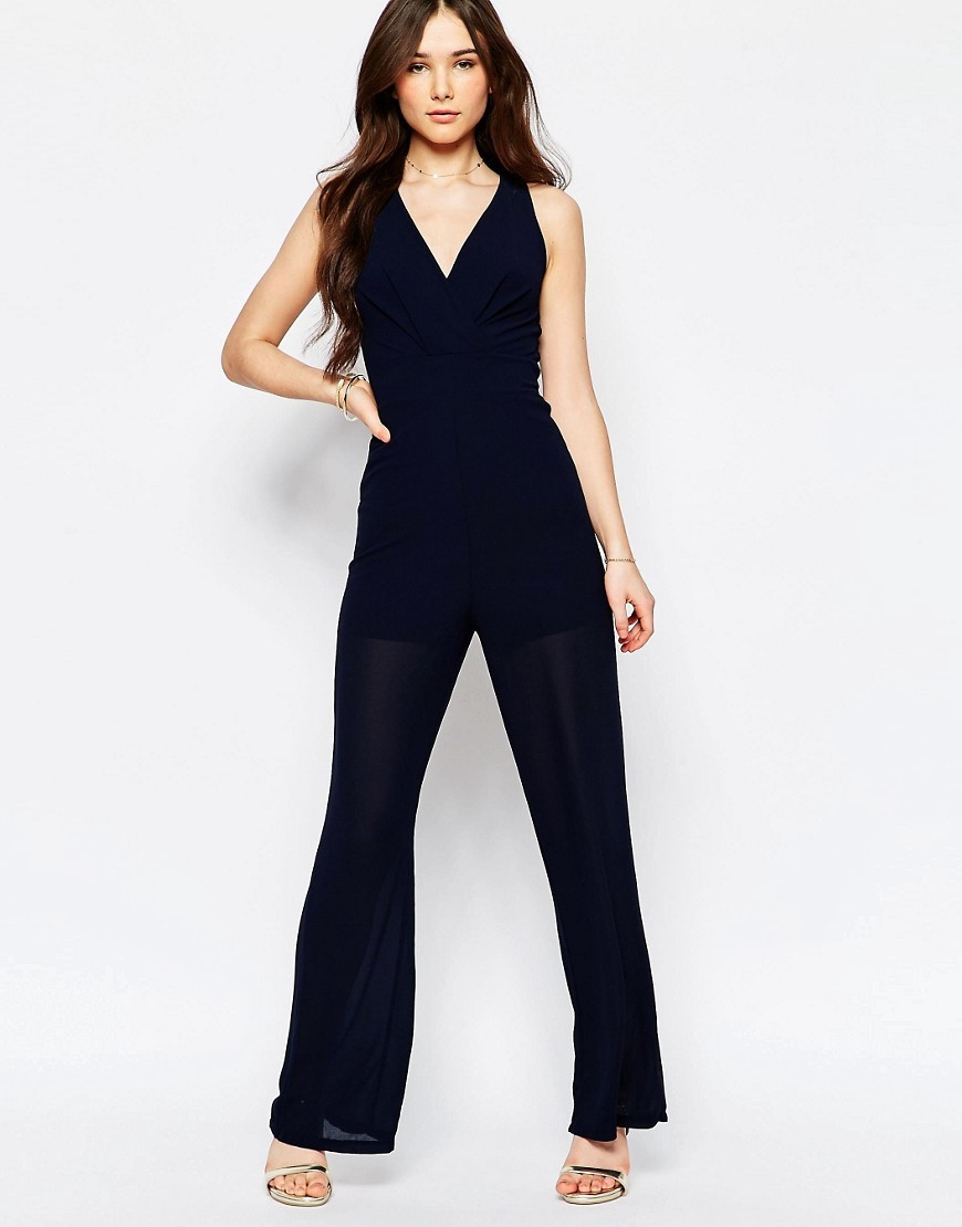 Jumpsuit With Tie Back Navy - length: standard; neckline: v-neck; pattern: plain; sleeve style: sleeveless; predominant colour: navy; occasions: evening; fit: body skimming; fibres: polyester/polyamide - 100%; sleeve length: sleeveless; style: jumpsuit; pattern type: fabric; texture group: jersey - stretchy/drapey; season: s/s 2016