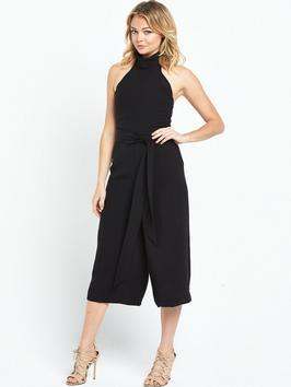 High Neck Culotte Jumpsuit - pattern: plain; sleeve style: sleeveless; waist detail: belted waist/tie at waist/drawstring; predominant colour: black; occasions: evening, occasion; length: calf length; fit: fitted at waist & bust; fibres: polyester/polyamide - 100%; sleeve length: sleeveless; texture group: crepes; style: jumpsuit; pattern type: fabric; season: s/s 2016; neckline: high halter neck; wardrobe: event