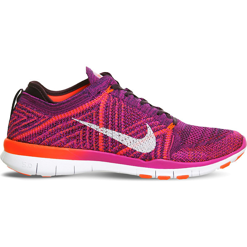 Free Tr Flyknit Woven Trainers, Women's, 3.5, Hyper Volt Crimson - secondary colour: white; predominant colour: hot pink; season: s/s 2016; brand specific: medium intensity; style: trainers; heel: regular trainer; heel height: flat; activities: lifestyle; pattern: patterned/print; type of pattern: light/subtle; material: technical fabric; finish: plain