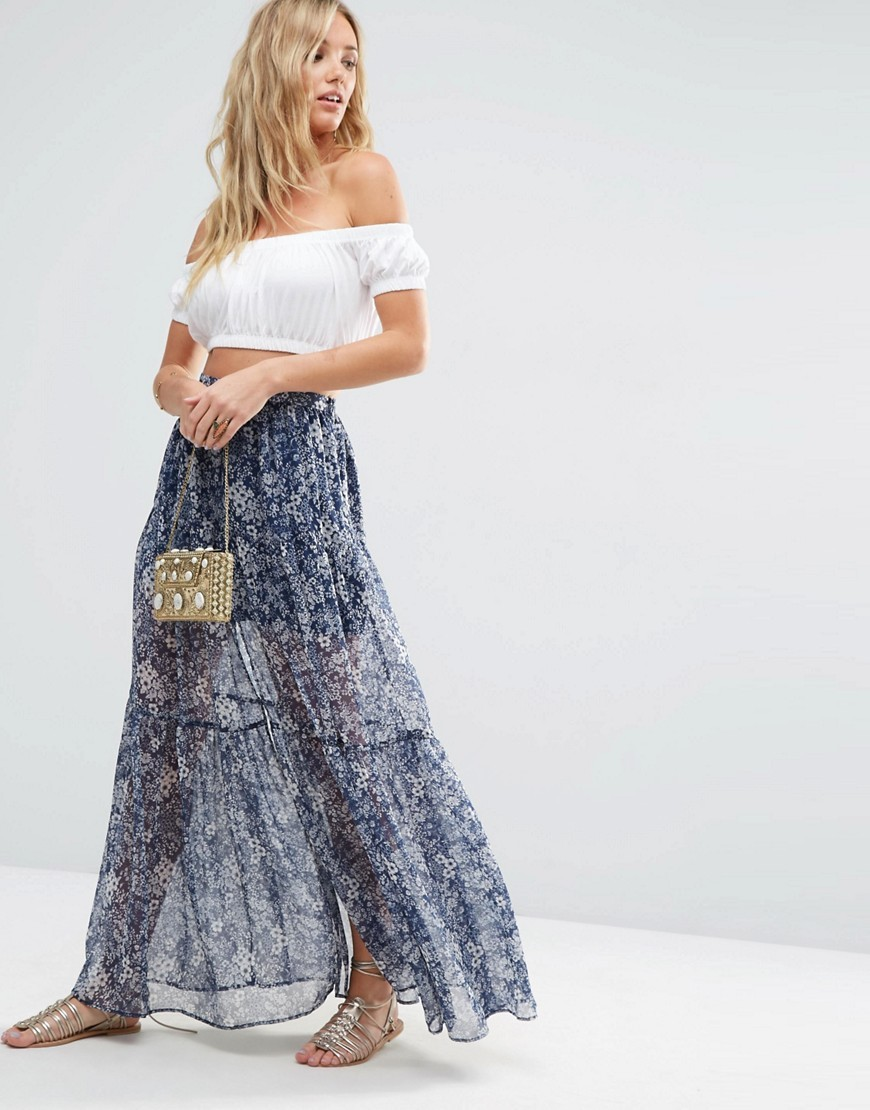 Tiered Maxi Skirt In Ditsy Floral With Front Split Multi - length: ankle length; fit: loose/voluminous; waist: high rise; predominant colour: denim; occasions: casual, holiday; style: maxi skirt; fibres: polyester/polyamide - 100%; hip detail: subtle/flattering hip detail; texture group: sheer fabrics/chiffon/organza etc.; pattern type: fabric; pattern: florals; pattern size: big & busy (bottom); season: s/s 2016; wardrobe: highlight