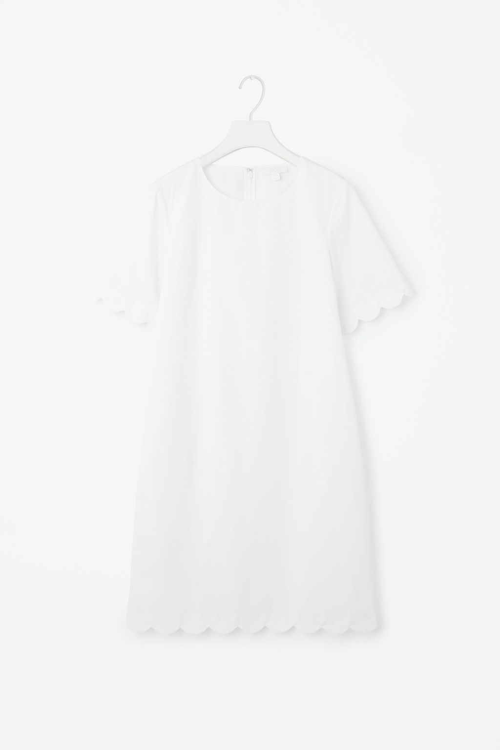 Scalloped Dress - style: shift; length: mid thigh; pattern: plain; predominant colour: white; occasions: evening, creative work; fit: soft a-line; fibres: polyester/polyamide - 100%; neckline: crew; sleeve length: short sleeve; sleeve style: standard; texture group: crepes; pattern type: fabric; season: s/s 2016; wardrobe: investment