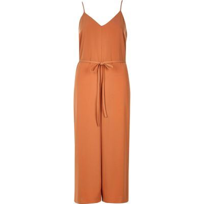 Womens Light Orange Cami Culotte Jumpsuit - neckline: low v-neck; sleeve style: spaghetti straps; fit: fitted at waist; pattern: plain; waist detail: belted waist/tie at waist/drawstring; predominant colour: terracotta; length: calf length; fibres: polyester/polyamide - 100%; occasions: occasion; sleeve length: sleeveless; texture group: crepes; style: jumpsuit; pattern type: fabric; season: s/s 2016; wardrobe: event