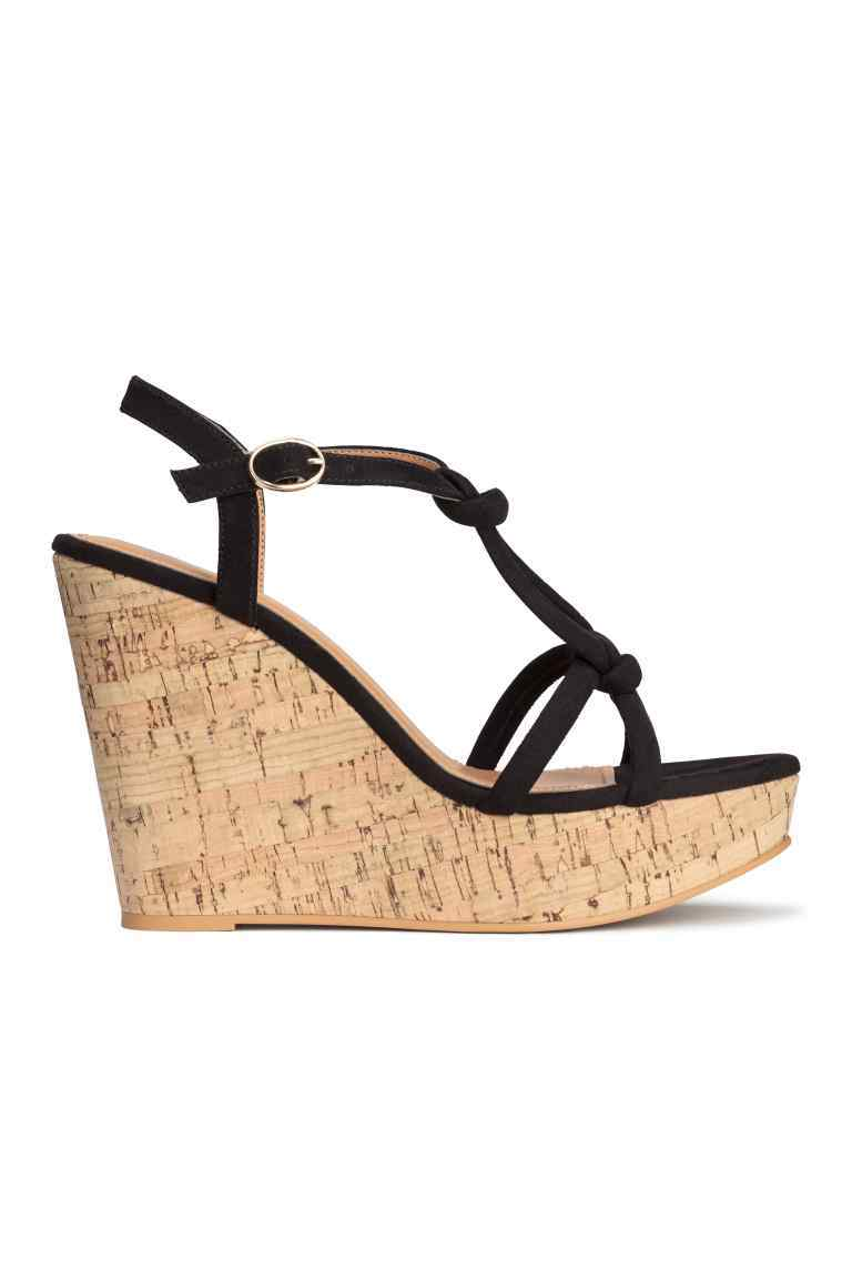 Wedge Heel Sandals - predominant colour: black; occasions: casual, holiday; heel height: high; heel: wedge; toe: open toe/peeptoe; style: standard; finish: plain; pattern: plain; material: faux suede; shoe detail: platform; season: s/s 2016; wardrobe: investment