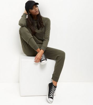 Khaki Sweater Jumpsuit - length: standard; neckline: round neck; pattern: plain; predominant colour: khaki; occasions: casual; fit: body skimming; fibres: polyester/polyamide - stretch; sleeve length: long sleeve; sleeve style: standard; style: jumpsuit; pattern type: fabric; texture group: jersey - stretchy/drapey; season: s/s 2016; wardrobe: highlight