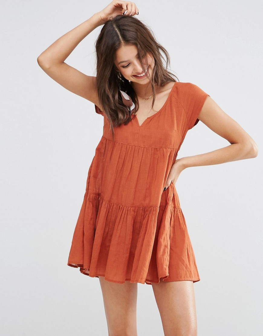 Tiered Smock Beach Dress Terracotta - style: smock; length: mini; neckline: low v-neck; sleeve style: capped; fit: loose; pattern: plain; predominant colour: terracotta; occasions: casual, holiday; fibres: cotton - 100%; hip detail: adds bulk at the hips; sleeve length: short sleeve; texture group: cotton feel fabrics; pattern type: fabric; season: s/s 2016; wardrobe: highlight